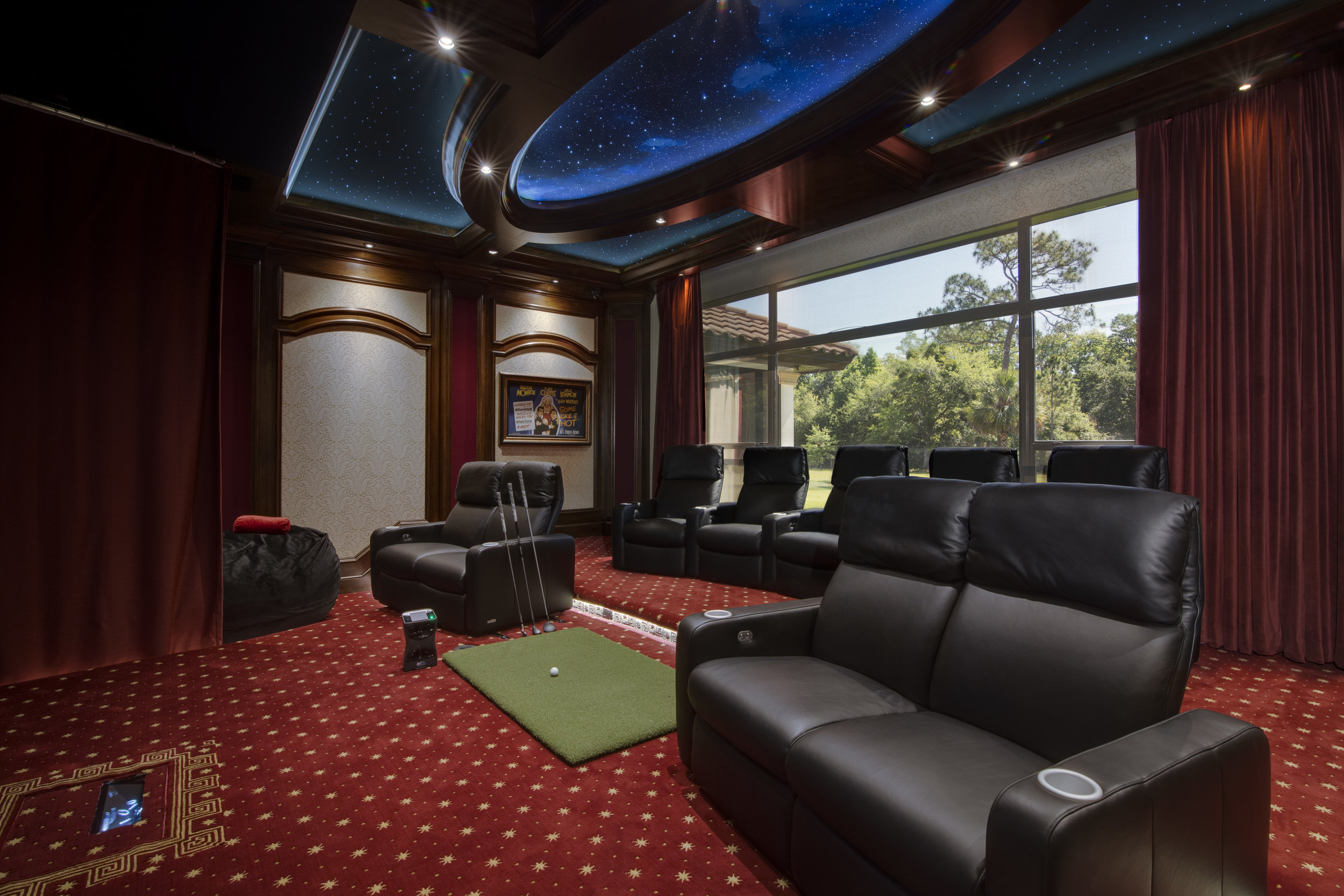 Heavy motorized curtains open to full wall of glass & Home Theater \u0026 Golf Simulator - TotalCare Orlando